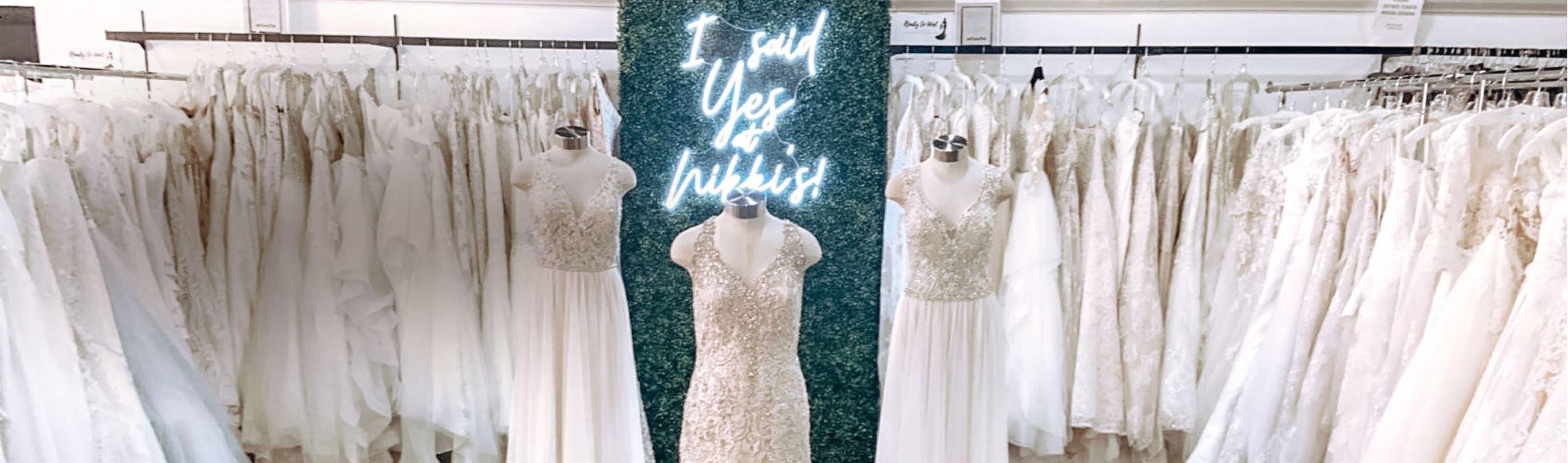 Models wearing white dresses