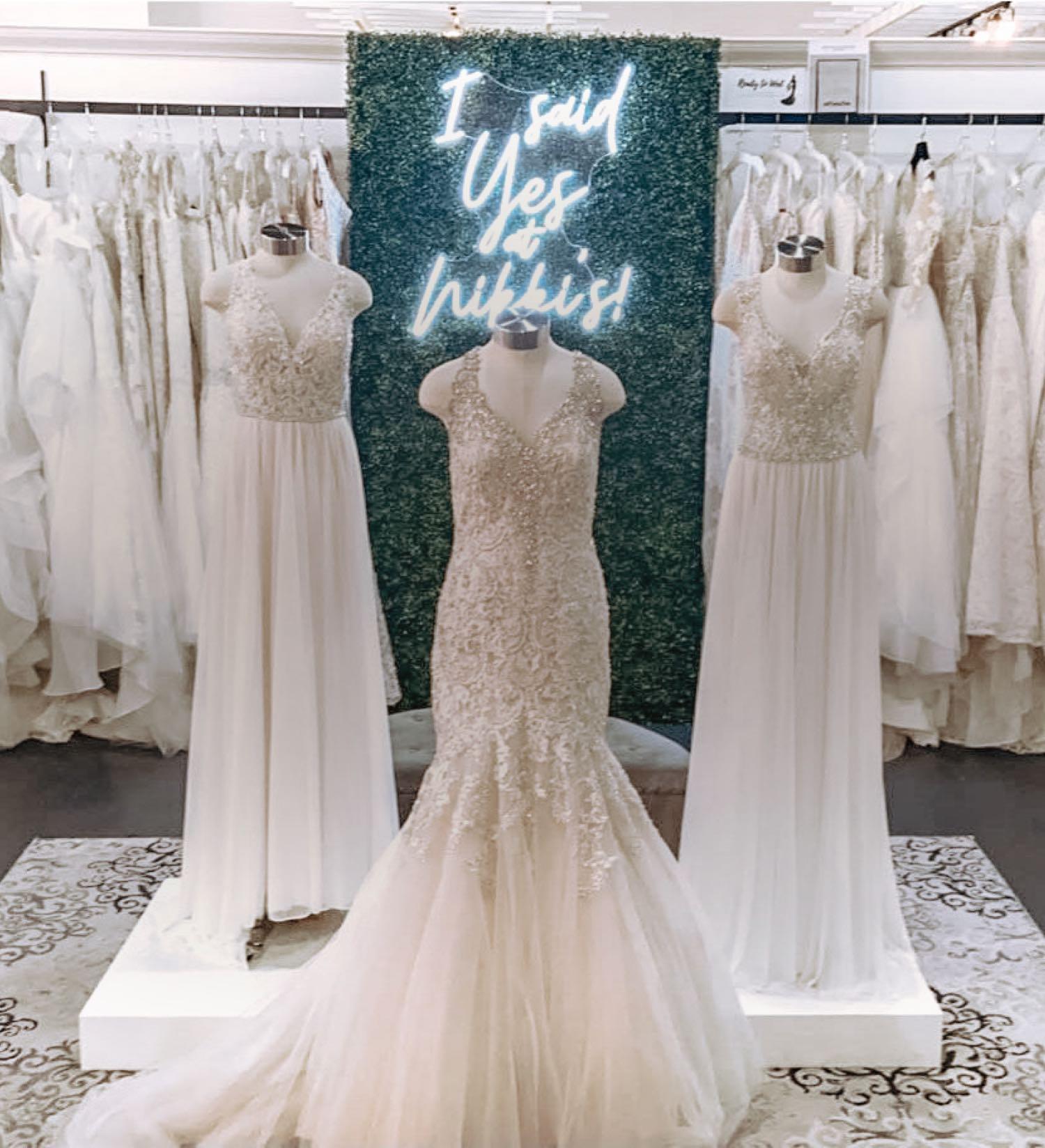 Models wearing white dresses. Mobile Image