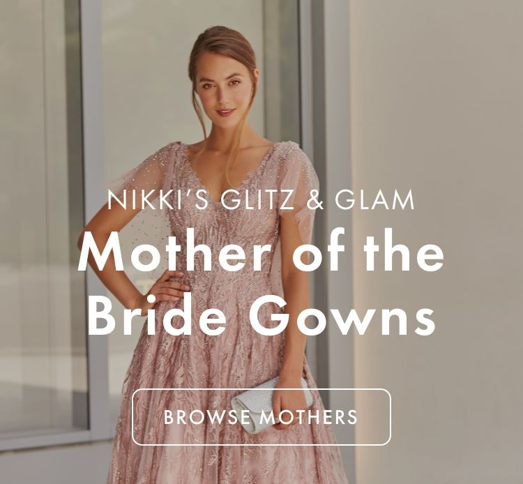 Woman in a blush pink mother of the bride gown