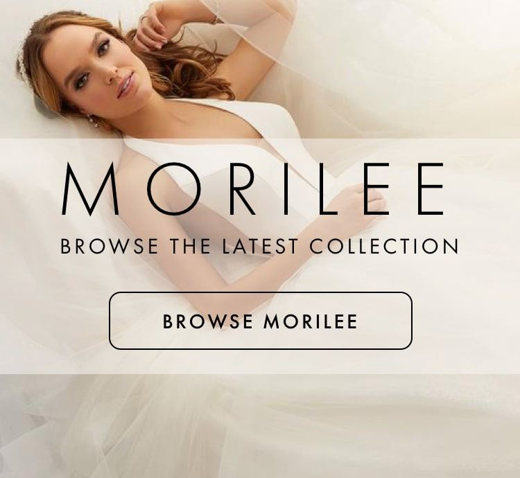 Woman laying down on a tulle Morilee wedding gown